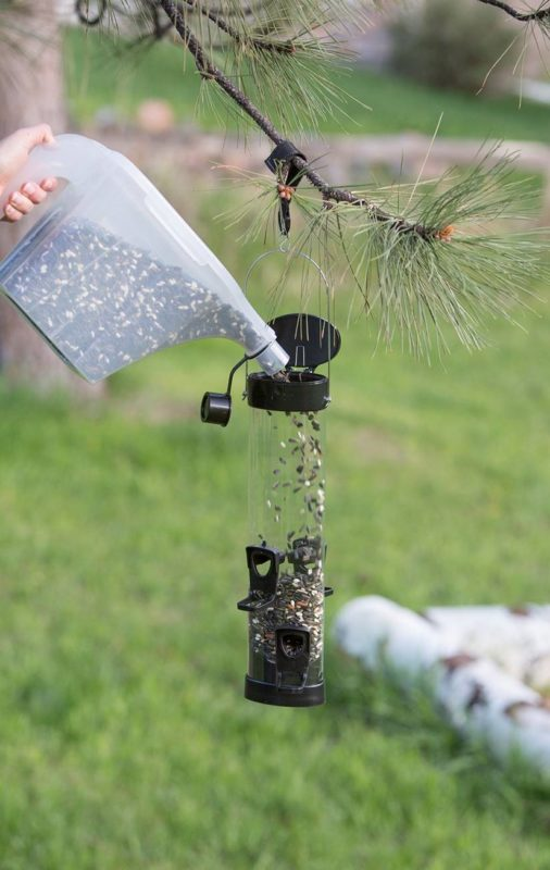 filling bird feeder with Stokes Select 3-in-1 tote