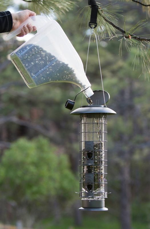 filling the Squirrel-X4 SureFill No Spill Squirrel-Resistant Bird Feeder with the Stokes Select 3-in-1 Super Tote