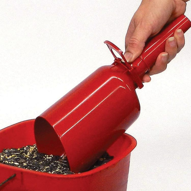 scooping bird seed with Stokes Select seed scoop