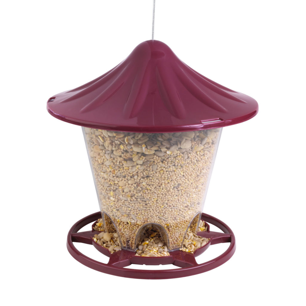 red Stokes Select Round Hopper Feeder filled with bird seed