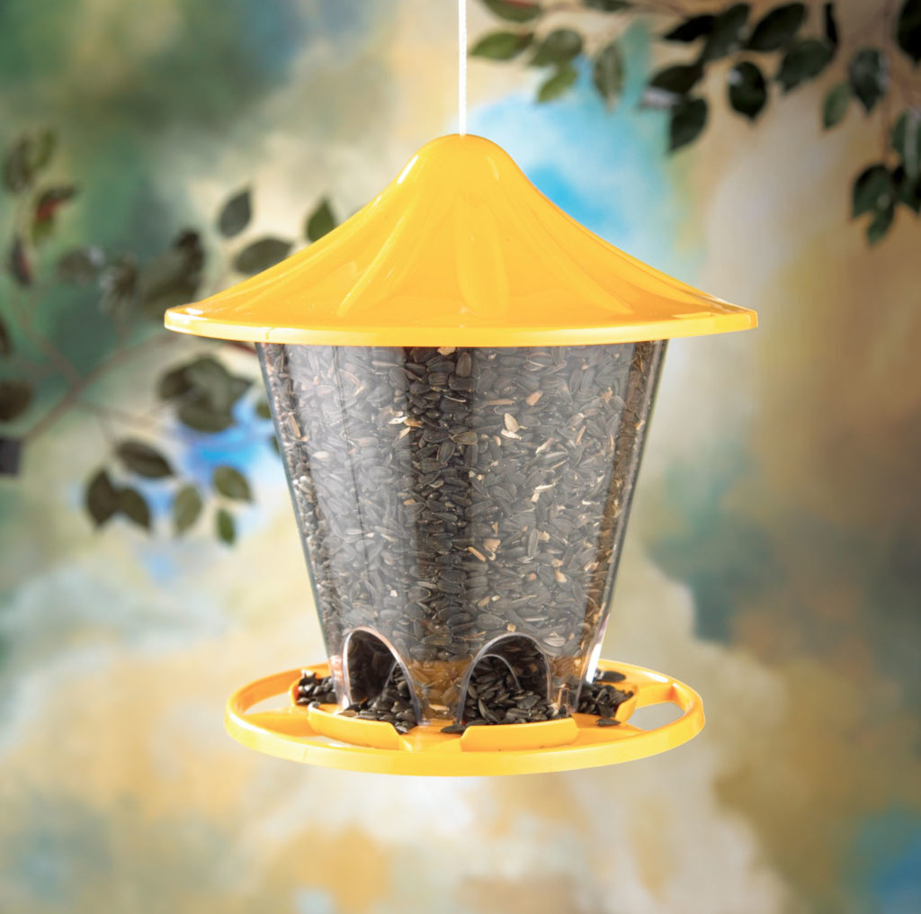 yellow Stokes Select round seed feeder filled with bird seed