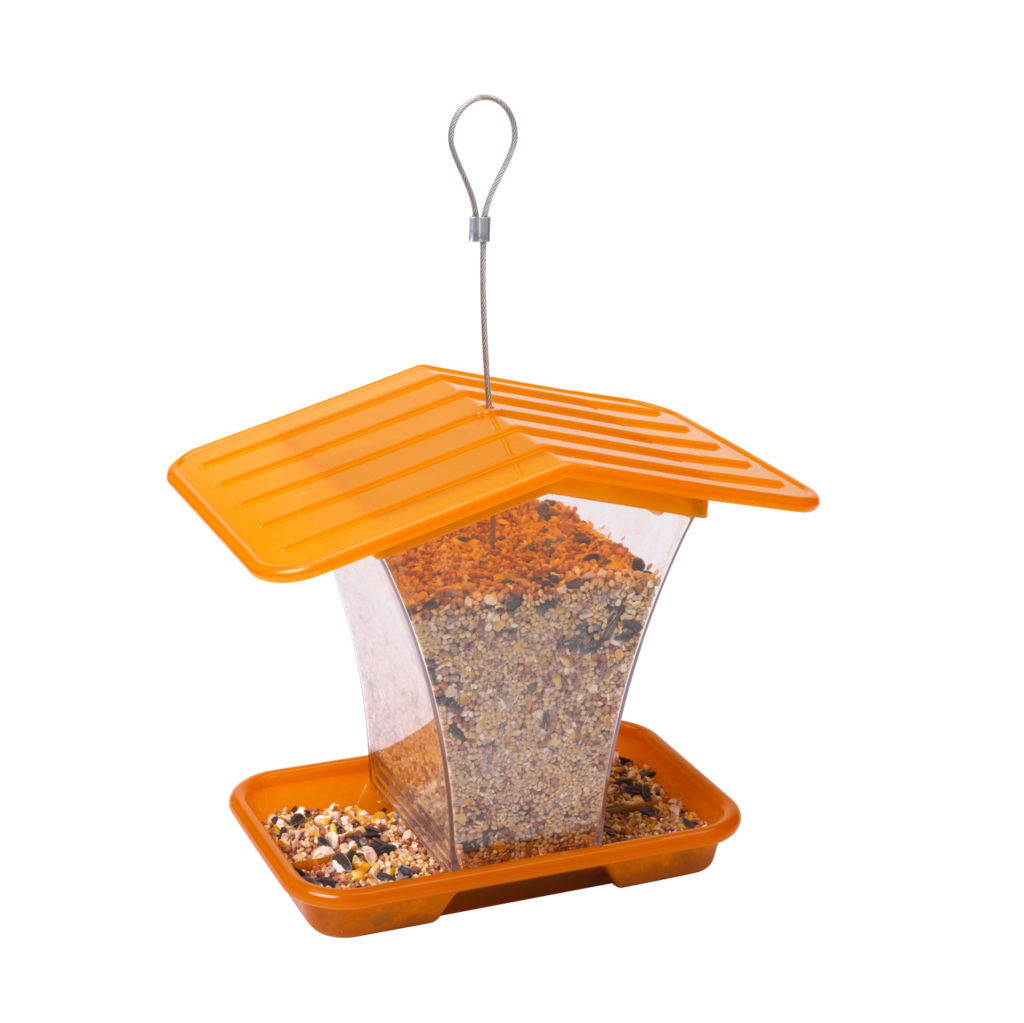orange Stokes Select plastic hopper feeder filled with bird seed