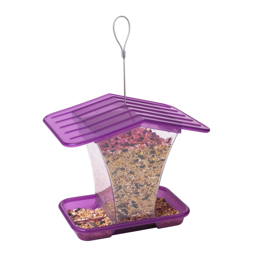 purple Stokes Select plastic hopper feeder filled with bird seed