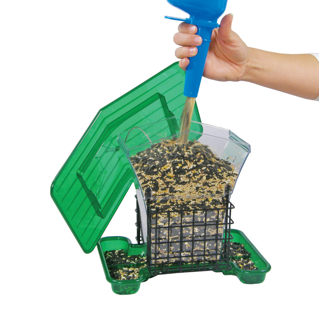 filling Stokes Select large plastic hopper feeder with suet cages with bird seed