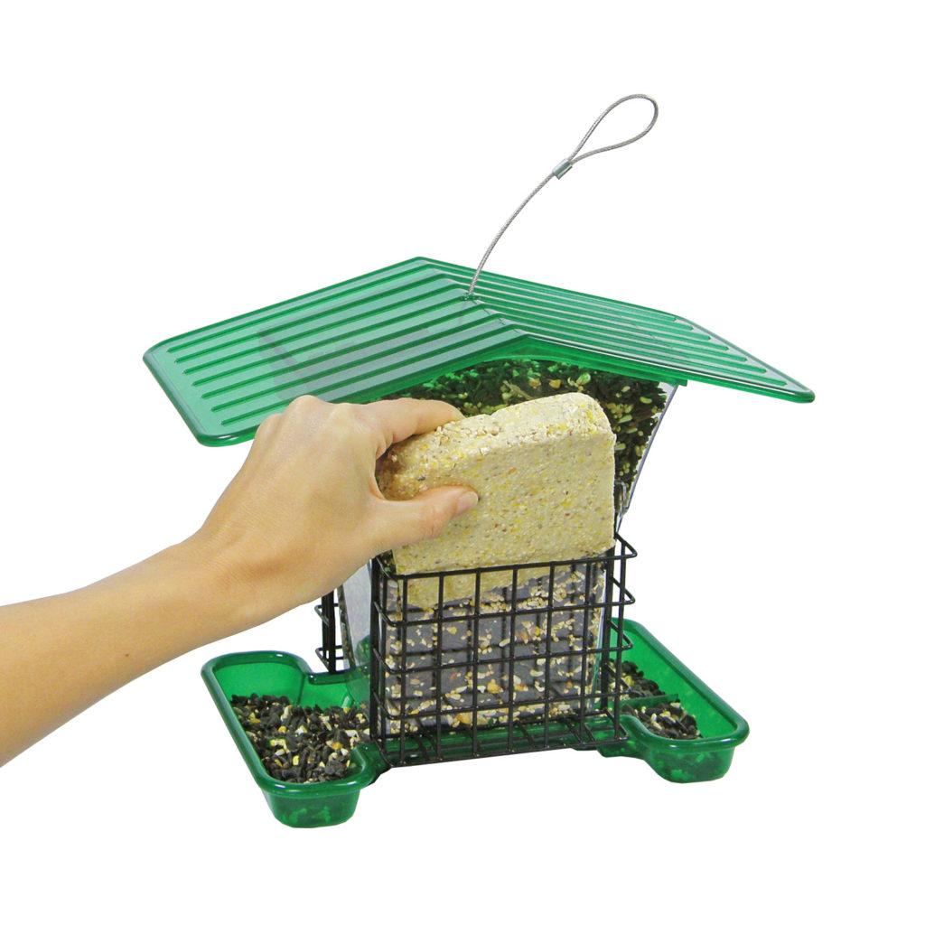 filling Stokes Select large plastic hopper feeder with suet cake