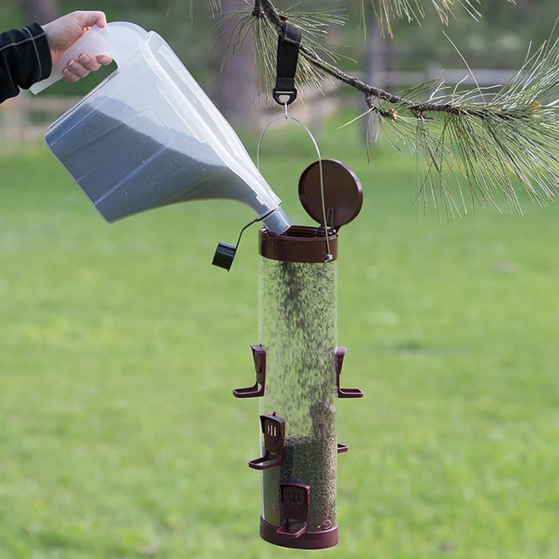 using Stokes Select Super Tote to fill Stokes Select large easy fill plastic tube feeder with bird seed